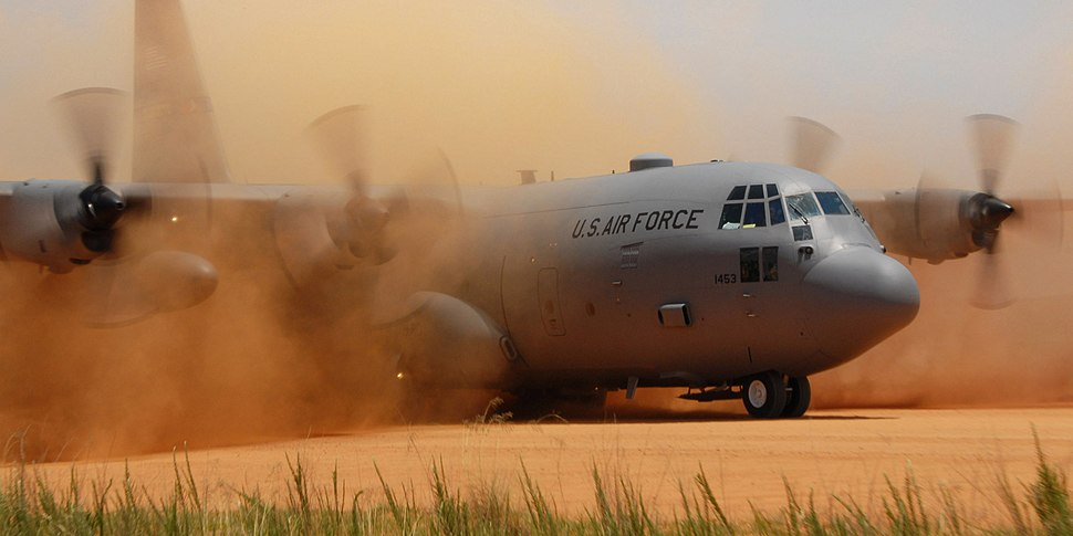 C-130 Hercules performs a tactical landing on a dirt strip