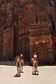 Camel riders at Petra, Jordan (6148172348).jpg