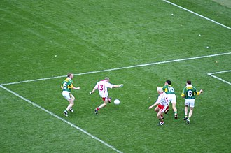 Peter Canavan -  Canavan (13, white) drilling home Tyrone's winning goal in the 2005 All-Ireland final