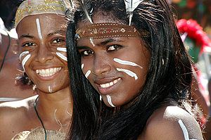 Dominican girls at carnival in Taíno garments and makeup (2005).