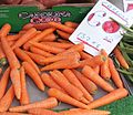 Carrots for sale on a UK greengrocer's market stall in August 2013.jpg