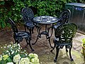 Cast iron outdoor table and chairs at Boreham, Essex, England.jpg