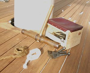 Caulking - The tools of traditional wooden ship caulking: caulking mallet, caulker's seat, caulking irons, cotton and oakum