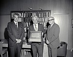 """Charles """"Charlie"""" Hall, Hans Mark and Sy Syvertson holding Pioneer 10 Plaque (4993456479).jpg"""