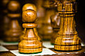 Chess pieces, pawn and rook.jpg