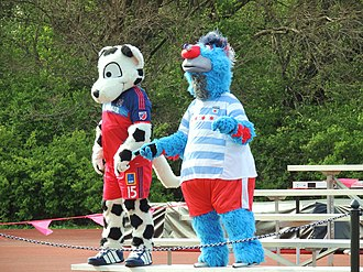 Chicago Red Stars - Chicago Fire mascot Sparky at a Red Stars game, alongside Supernova the Red Stars mascot