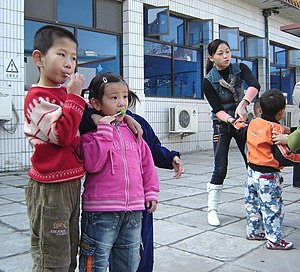 Children of the Stars - Feng Jia Wei (far left) and a friend  at the Beijing Stars and Rain School.