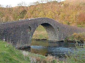 Seil - Fast-flowing sea water under the 18th century Clachan Bridge that links Seil to mainland Scotland