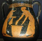 Photograph of a red-figure vase showing two women washing clothes