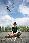 Colony High School Junior ROTC Cadet Morgan Chapman, 14, keeps control of a static line while.jpg