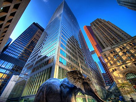 A view of the Financial District from Commerce Court. The district acts as the city's central business district. Commerce Court and mammoth statue.jpg