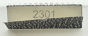 Personal identification number - A personal identification number sent to its user in a letter. The darkened paper flap prevents the number from being read by holding the unopened envelope to the light.