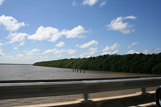 Transport in Suriname - The Coppename Bridge over the Coppename River near Boskamp.