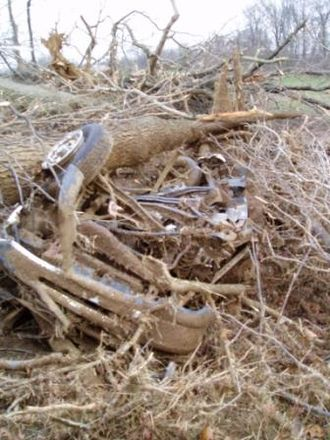 March 2009 tornado outbreak sequence - The remains of a truck, crushed by trees, which was thrown roughly a quarter mile by the tornado