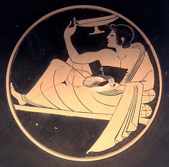 Symposium - Kottabos player flinging wine-dregs (Attic red-figure kylix, c. 510 BC).