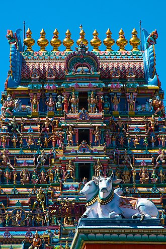 Culture of India - Cows depicted in the decorated gopuram of the Kapaleeshwarar temple in Chennai.