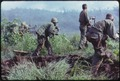 Dak To, South Vietnam. An infantry patrol moves up to assault the last Viet Cong position after an attempted overrun... - NARA - 530611.tif