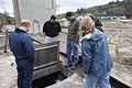 Dan Ashe and staff view damaged plumbing (6978261674).jpg