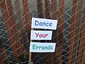 Dance your errands. Sign on the back of my bike that day (3633513191).jpg