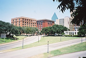 Dealey Plaza - View from southwest, with the former Texas School Book Depository building at left, and the Dal-Tex Building, right next to it
