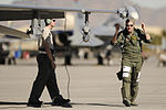 Defense.gov News Photo 120126-F-YL744-964 - Capt. John DiFebo conducts a pre-flight inspection on an F-16 Fighting Falcon during Red Flag 12-2 at Nellis Air Force Base Nev. on Jan. 26.jpg