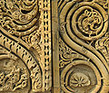 Details of stone creepers, Quwwat ul-Islam mosque arched screen, Qutb complex.jpg
