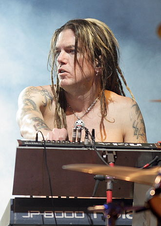 Guns N' Roses - Dizzy Reed joined the band as keyboardist in 1990.
