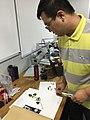 Dr Yang Tuo scanning plants at CNGB Herbarium.jpg