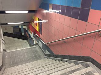 Dufferin station - Renovated staircase with multicoloured tile design.