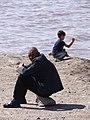 Elderly Man and Boy at Lakeshore - Lake Ourimiyeh - Western Iran (7421766712).jpg