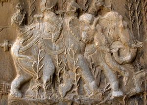Persian war elephants - Sasanian relief of boar-hunting on domestic elephants, Taq-e Bostan, Iran