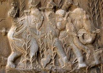 Persian war elephants - Sasanian relief of boar-hunting on domestic elephants, Taq-e Bostan, Iran