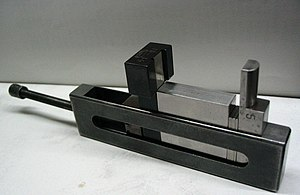 Gauge block - A holder that turns a stack of gauge blocks into an instant, custom caliper or go/no go gauge.