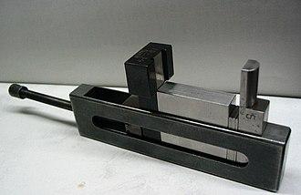 Gauge block - A holder that turns a stack of gauge blocks into an instant, custom caliper or go/no go gauge.