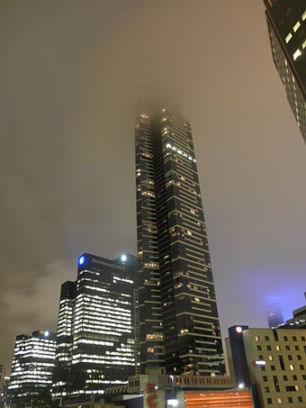 Eureka Tower, Melbourne's tallest building, shrouded in fog Eureka Tower covered in low clouds at night.jpg