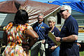 FEMA - 44145 - Community Relations and State Workers speak with a resident in the field in Mississippi.jpg