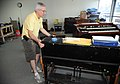 FEMA - 45003 - Music Shop owner Murph Wanca moves instruments around his shop in Tennessee.jpg