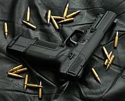 Photo of an all-black Five-seven USG with an extended 30-round magazine