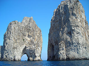 Natural arch in the Faraglioni di Capri - Italy