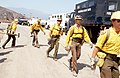 """Firefighters from the Vandenburg Air Force Base fire department, known as the """"Hot Shots,"""" move out from a staging area near Dos Pueblos High School to battle brush fires that swept - DPLA - ba5444888e721a9c7a55a44348e0811f.jpeg"""