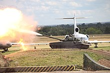 51df230626ca A T-90A tank firing its main gun at Engineering Technologies 2012.
