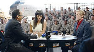 First Take (TV series) - Stephen A. Smith (left), Cari Champion (center), and Bayless (right) during a broadcast at McGuire Air Force Base in 2014