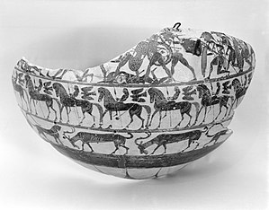 Cavalcade Painter - Fragment of a middle corinthian terracotta column-krater (ca. 590–570 B.C.), depicting a band of fighting warriors, a cavalcade of riders, and a band of goats and panthers; Metropolitan Museum of Art (12.229.9)