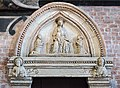 Frari (Venice) nave left - The tympanum of the door bell tower High relief of the fourteenth.jpg