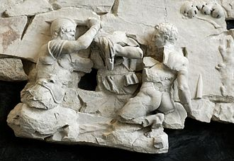 Ficus Ruminalis - A scene of combat, perhaps between Romulus and Remus, described by some ancient authors as having taken place near the Ficus Ruminalis. Pentelic marble, fragment from the frieze of the Basilica Aemilia, 1st century BC–1st century AD.