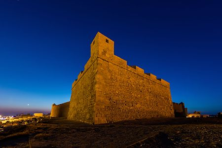 Night view of the fortress of Bordj el Kebir and the moon over it, Mahdia, Tunisia.
