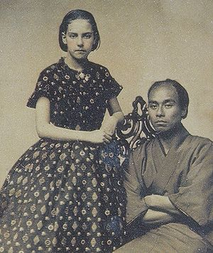 Fukuzawa Yukichi - Fukuzawa Yukichi (posing with the photographer's twelve year old daughter: Theodora Alice Shew) in San Francisco, 1860.