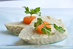Gefilte fish topped with slices of carrot.jpg