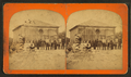 Group of boys and girls in front of unidentified brick structure, by J. S. Lefavour.png