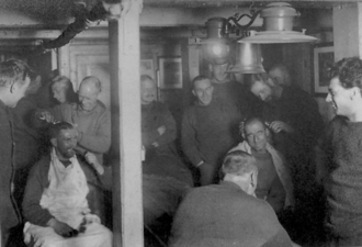 Harry McNish - The crew have their hair cut aboard Endurance. McNish is on the left shaving Greenstreet's head.